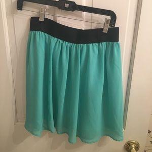Light blue/teal mini skirt with elastic waist